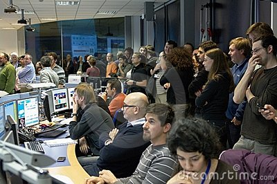 Physicists in the experiment control room Editorial Stock Image