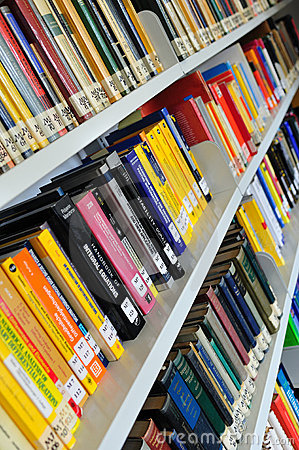 Physics books on shelves Editorial Image