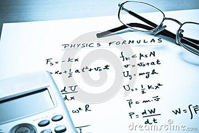 Physics formulas written on a white paper