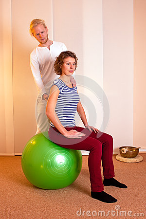 Physiotherapist Correcting, Posture