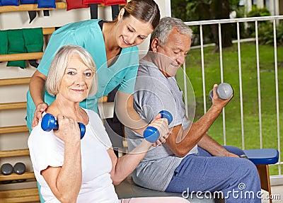 Physiotherapist helping senior
