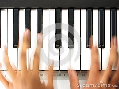Pianist in action, playing a piano