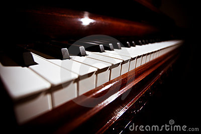 Piano keyboard under soft lighting