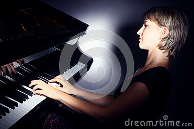 Piano pianist player with grand piano