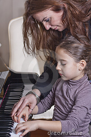 Free Piano Teacher Royalty Free Stock Image - 13242296