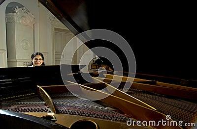 Piano Teacher Across Baby Grand