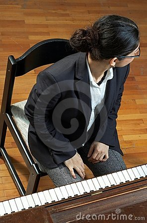 Piano Teacher Looking Away
