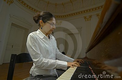 Piano Teacher Playing From Keyboard Viewpoint