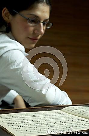 Piano Teacher Reading Music