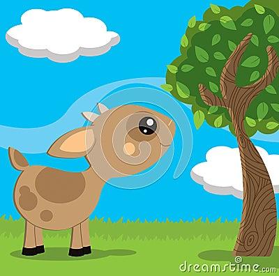 Piccola capra sveglia in un paesaggio della campagna