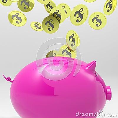 Pièces de monnaie entrant dans la tirelire montrant des dépôts de l Angleterre