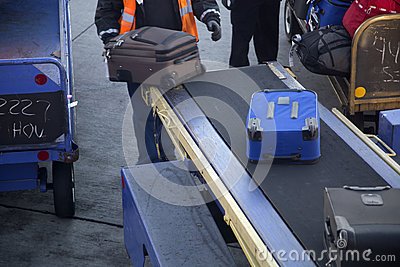 Pick up suitcase in airport