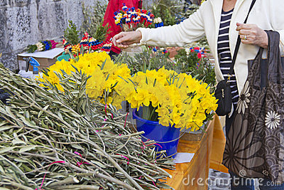 Picking flowers on market