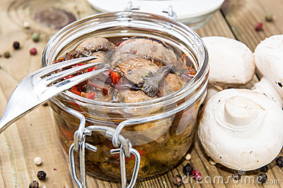 Pickled mushrooms in a glass
