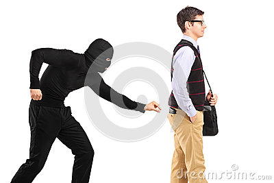 A pickpocket with mask trying to steal a wallet