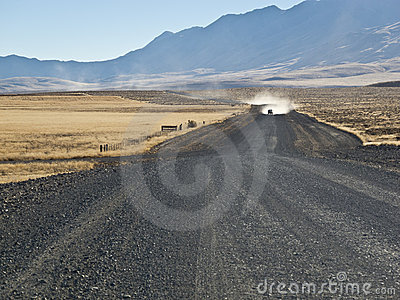 Pickup truck approaching on a gravel road