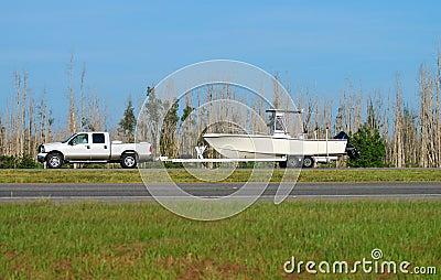 Pickup truck hauling boat