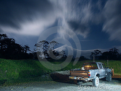 Pickup truck in moonlight near Arenal Volcano