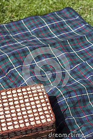 Picnic basket on blanket