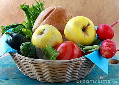 Picnic basket full of fresh food bread, fruit