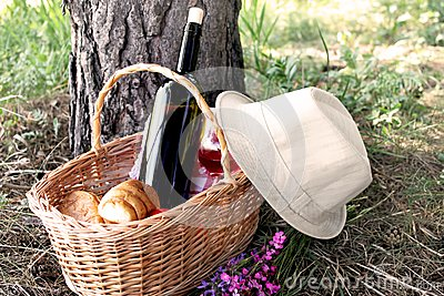 Picnic basket with a hat placed near