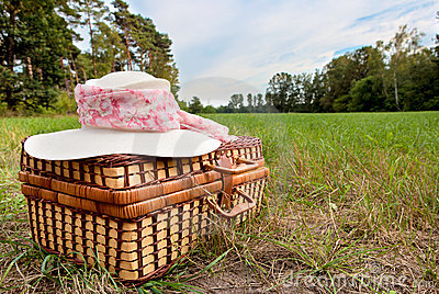 Picnic basket with straw hat