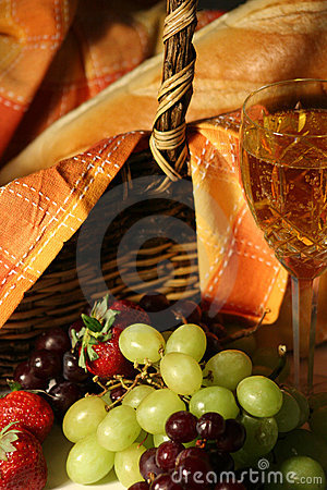 Picnic basket with wine, fruit and bread