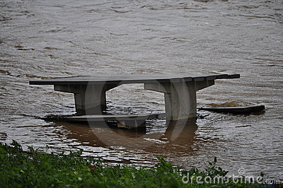 Picnic bench in flood waters Editorial Stock Image