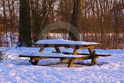 Picnic bench in snow