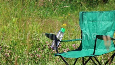Pleasant A Picnic Chair Stands On A Light Flooded Meadow Herbs And Flowers Sway From The Summer Wind Hands Green Creativecarmelina Interior Chair Design Creativecarmelinacom