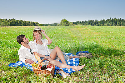 Picnic - Romantic couple in sunny meadows