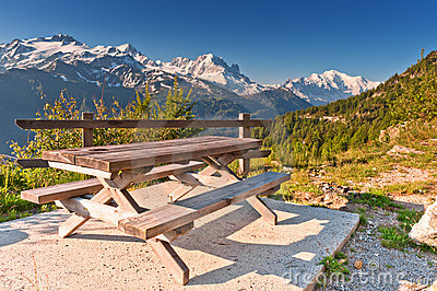 Picnic table and benches in mountains