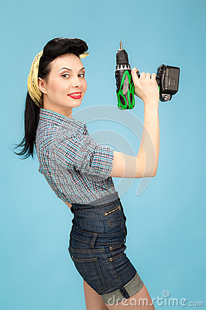 Picture of beautiful pin up woman with tool