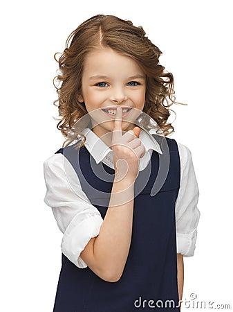 Pre-teen girl showing hush gesture