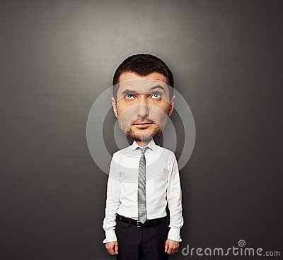 Picture of bighead man in white shirt