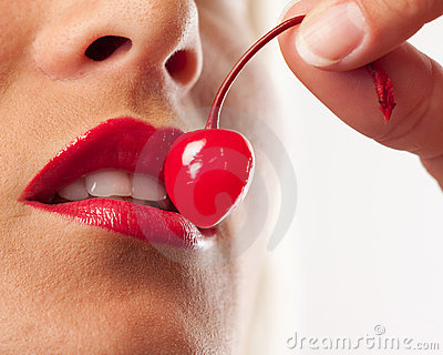 Picture  of cocktail cherry, lips and white teeth