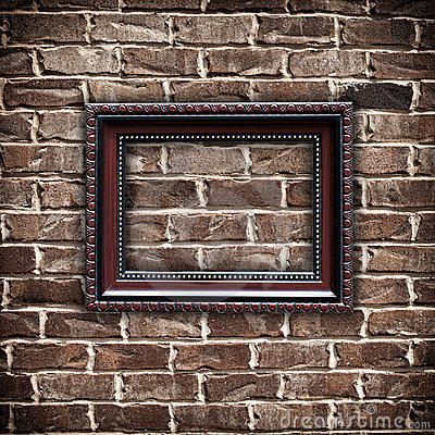 Picture frame on grunge brick wall