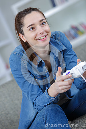 Picture happy woman with joystick playing video games Stock Photo