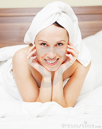 Picture of smiley woman in bed