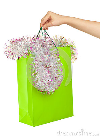 Picture of woman s hand with green shopping bag