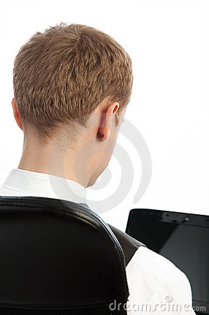 Picture of young businessman from behind