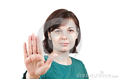 Picture of a young woman doing a stop gesture