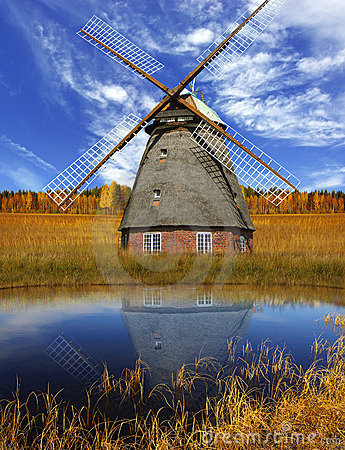 Picturesque autumn landscape with old mill