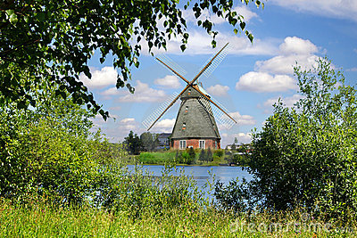 Picturesque landscape with old mill and lake