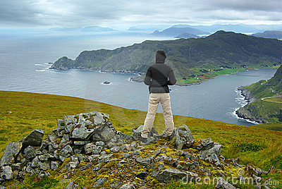Picturesque Norway landscape with tourist.