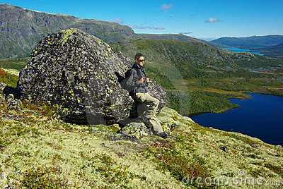 Picturesque Norway mountain landscape with tourist
