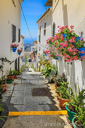 Free Picturesque Street Of Mijas With Flower Pots In Facades. Andalus Royalty Free Stock Image - 114436816