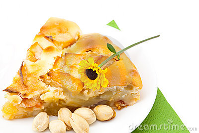 Piece of apple pie and a flower