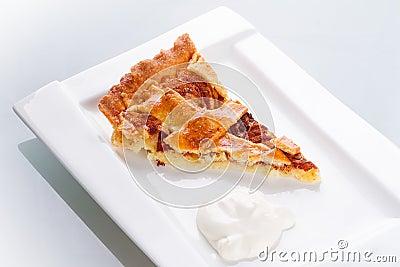 Piece of apple tart and cream