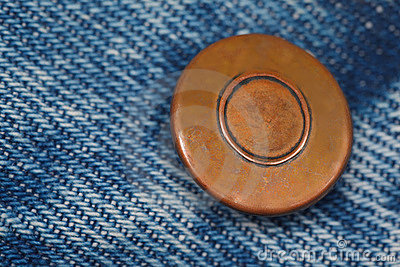 Piece of blue denim structure of the yellow button